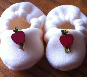 Finished plush baby booties with trim