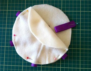 Showing how to pin ribbon on