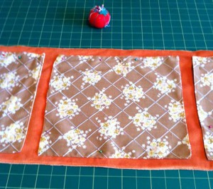 Square pieces sewn on to rectangle