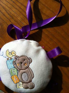 Plush baby toy stuffed with  top edge pinned