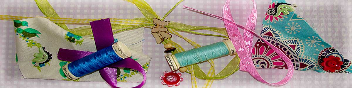 Banner with scrap fabric, threads, ribbons and buttons