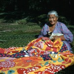 Woman sewing a patchwork quilt