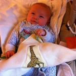 Baby Lilly holding taggie blanket