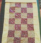 history of patchwork quilting